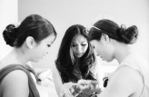 Preparing with her sisters. Kodak Tri-X, Leica 90mm Summicron