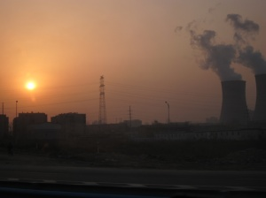 The sun was rising and there's the coal power station.