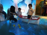 Mommy teaching AA how to fish ducks!