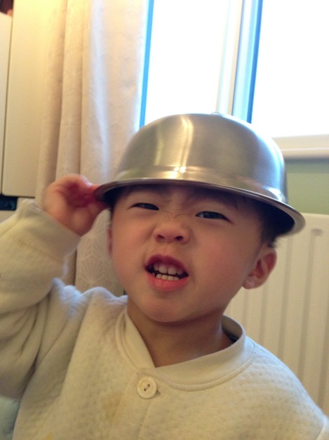 A steel bowl becomes a helmet for Ashton!