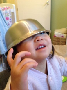 Annabelle wanted to try on the new 'helmet' after seeing Ashton had lots of fun with it.