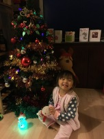 Posing next to the Christmas tree.