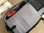 Close and zip up the protective flap. Notice that there's small space left on top? You can put the guards...