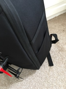 One side even has a elastic strap for holding something like a monopod or something.