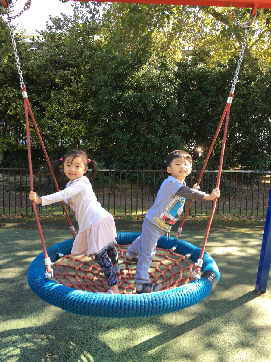 Sharing the swing.